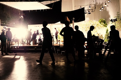 movie crew team working in silhouette of camera and equipment set in studio